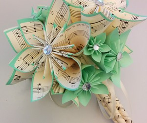 paper flowers, sheet music, and wedding boquet image