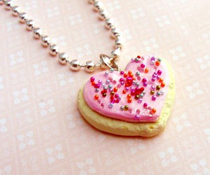 cookie, necklace, and sprinkles image
