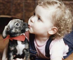 child, dog, and kiss image