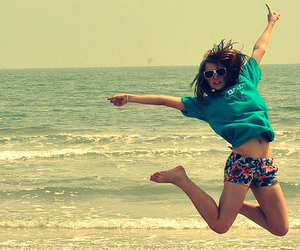 girl, beach, and jump image