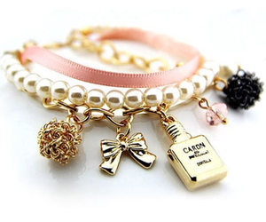 bracelet, bow, and gold image