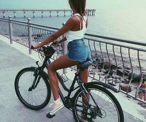 bike, brunette, and ocean image