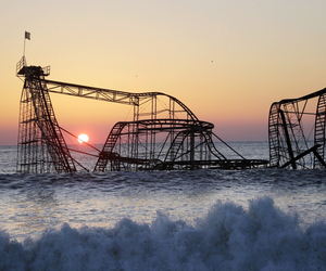 sunset, sea, and rollercoaster image