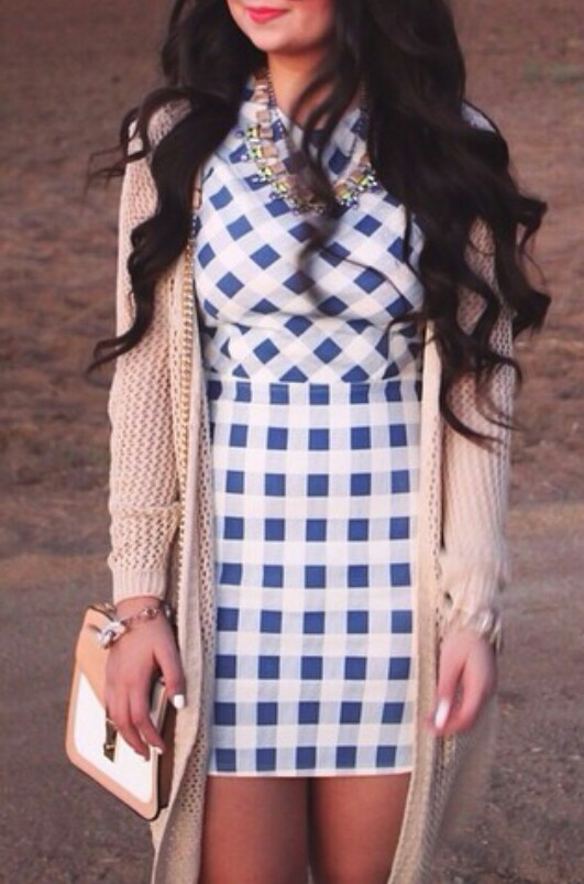 white nails, white & beige purse, and bracelets image