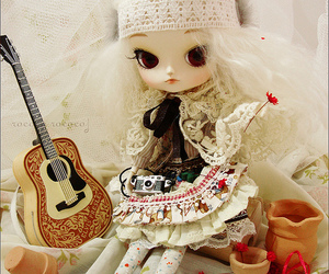 brown, cream, and doll image