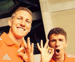 thomas muller, bastian schweinsteiger, and germany image