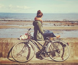 girl, bike, and sea image