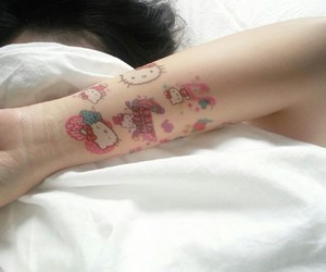hello kitty, pink, and tattoo image