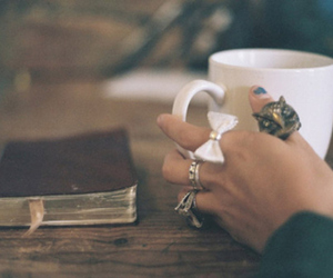book, rings, and coffee image