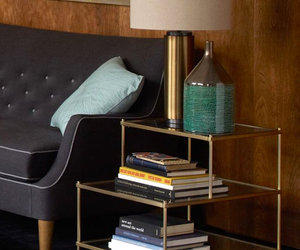 brass and glass furniture, brass ceiling lights, and brass and mirrored glass image