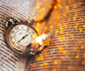 book, clock, and light image