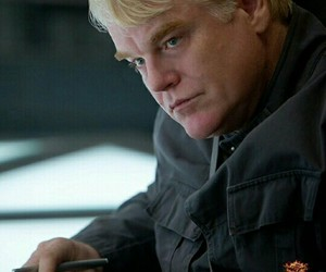 mockingjay, the hunger games, and plutarch image