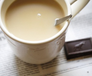 dark chocolate, newspaper, and tea image