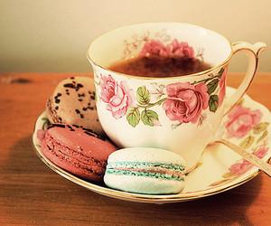 tea, macarons, and cup image