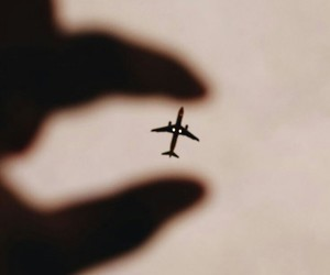 plane, airplane, and hand image