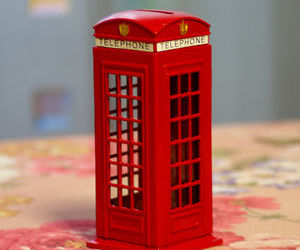 red telephone booth, saving bank, and london souvenir image