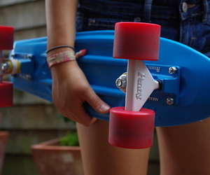 girl and penny board image