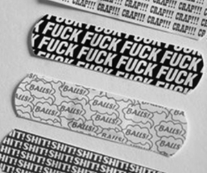 black and white, plasters, and swear words image