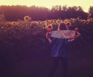 girl, skateboard, and sunflower image