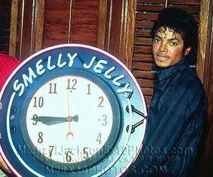 clock, michael jackson, and thriller era image