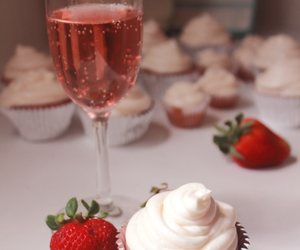 champagne, cupcakes, and strawberries image