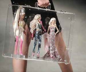 barbie, doll, and bag image
