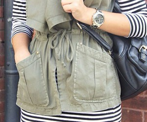 striped dresses, silver watches, and black leather backpack image