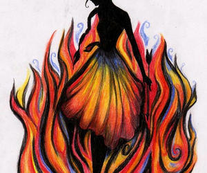 katniss, fire, and the hunger games image