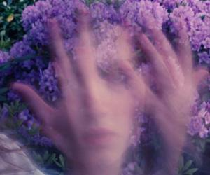 girl, flowers, and hands image