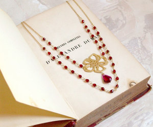 book, burgundy, and jewelry image