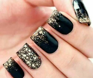 black nails, nails, and gold glitter nails image