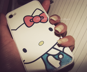 hello kitty, iphone, and shell image