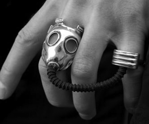 ring, gas mask, and black and white image