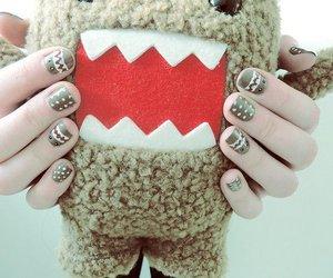 nails and domo image