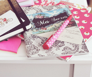 notebook, book, and pen image