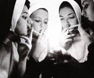 nun, smoke, and cigarette image