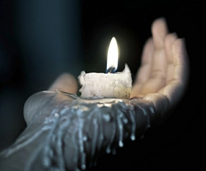 hand, candle, and fire image