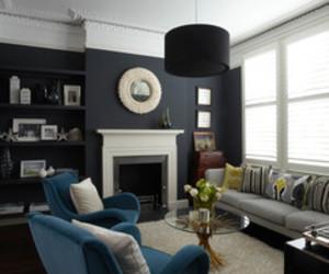 big windows, fireplace, and black walls image