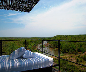 balcony, day bed, and safari image