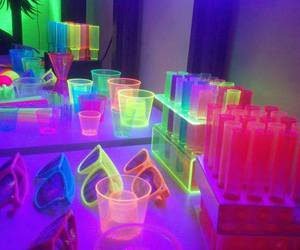 bottles, sunglasses, and neon image
