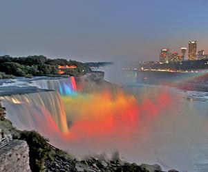 waterfall, rainbow, and city image