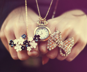 rings, flowers, and clock image