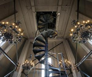spiral staircase and chandeliers image