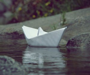 paper boat, water, and river image