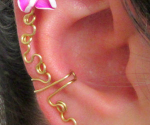 cuff, earring, and flower image