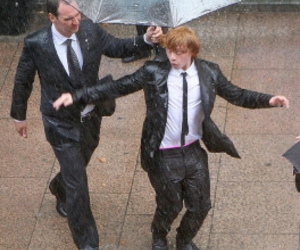 rupert grint, rain, and harry potter image
