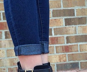 dark blue jeans, black cutout boots, and black cutout booties image