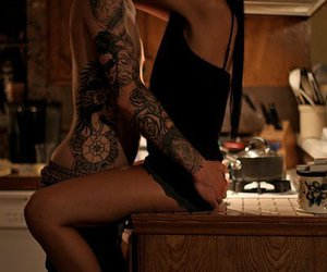 couple, tattoo, and kitchen image