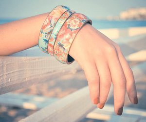 bracelet, hand, and flowers image
