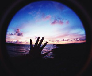 hand and ocean image